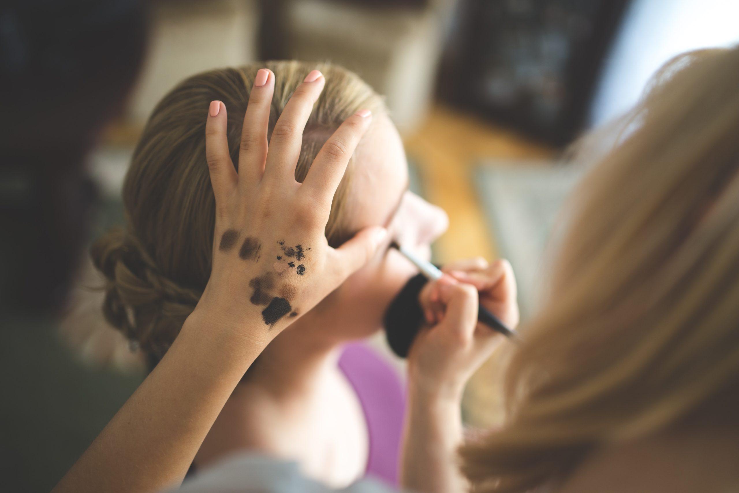 Photo of Happy Makeup Artist applying makeup Windsor Toronto Ontario Canada