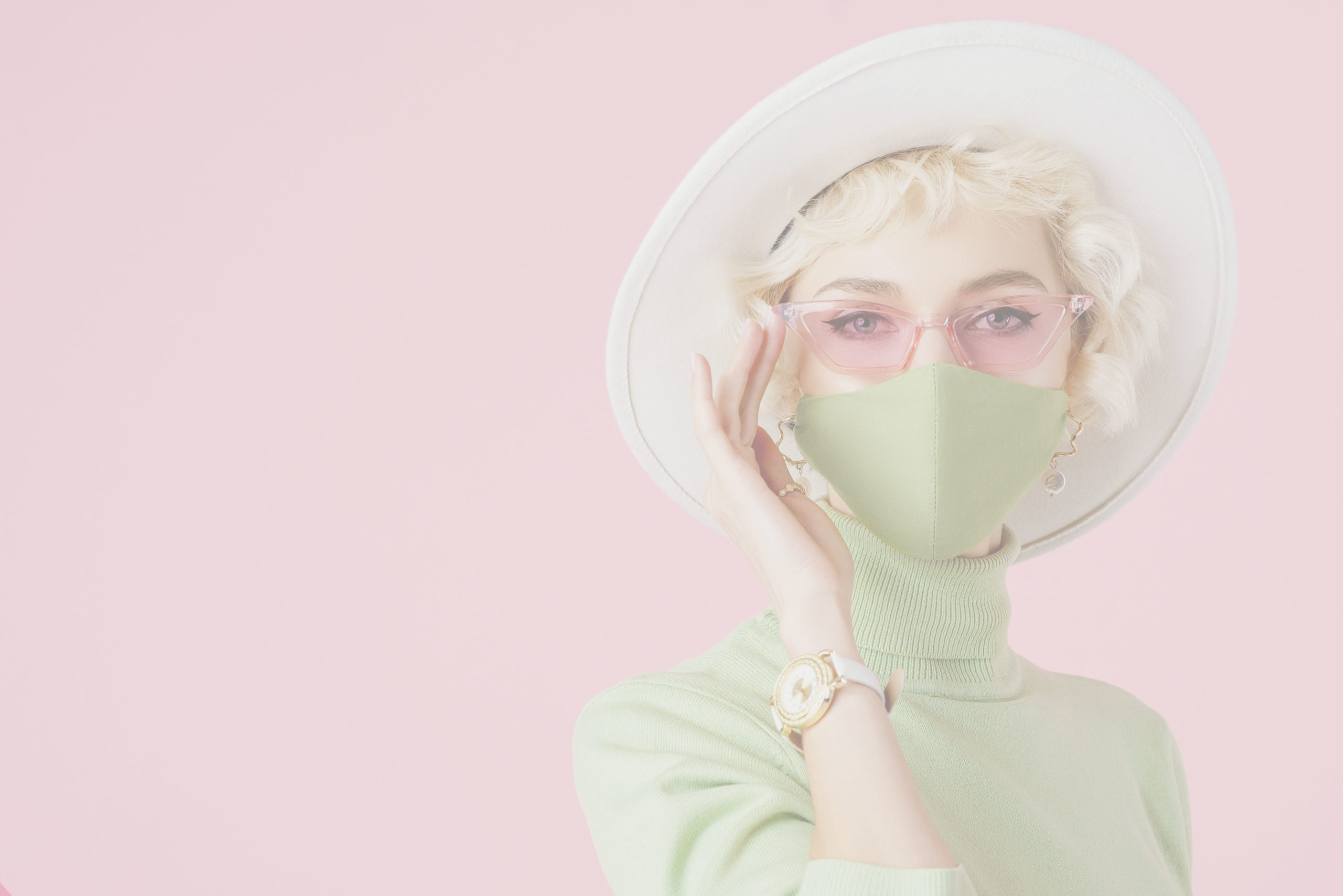 Face Mask Safety Certified Artists Beaux Beauty on demand app Woman wearing trendy fashion outfit during quarantine of coronavirus outbreak. Model dressed protective stylish handmade face mask, pink sunglasses, white hat, wrist watch, green mint color turtleneck